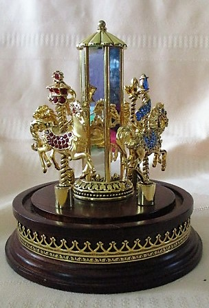 Franklin Mint Carousel of Pins (4 Rhinestone Carousel Horse Pins with Mirrored Stand)